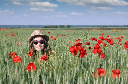 season: happy little girl in meadow spring season