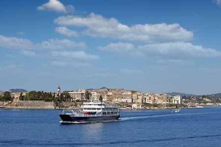 corfu: ferry boat sails close to Corfu town Stock Photo