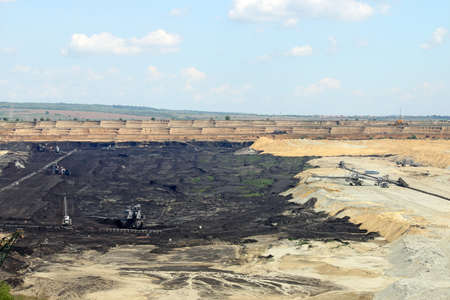 open pit: open pit coal mine with excavators  and machinery mining industry Stock Photo