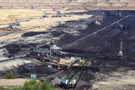 open pit: open pit coal mine with machinery and excavators mining industry
