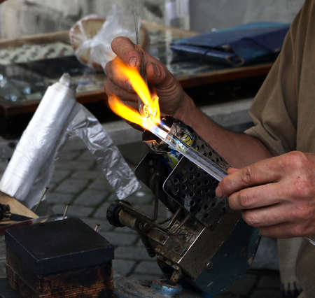 figurines: Blowing glass figurines with flame craft Stock Photo