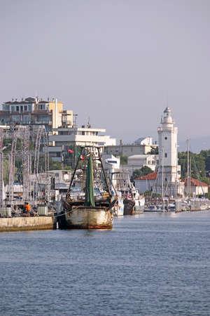 rimini: old fishing boat and lighthouse Rimini port Stock Photo