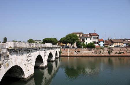 rimini: Tiberius bridge and old buildings Rimini Italy Stock Photo