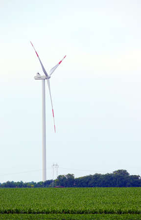 electric generating plant: wind turbine on soya bean field renewable energy Stock Photo