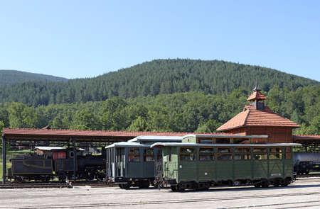 wagons: railway station with old wagons and steam locomotive