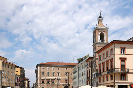 martiri: old buildings and clock tower Piazza Tre Martiri Rimini Italy Stock Photo