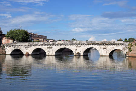 historical reflections: old stone Tiberius bridge landmark Rimini Italy