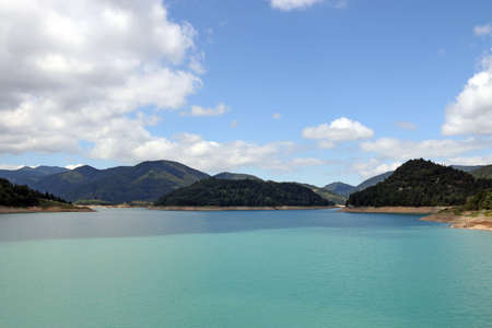 lake hills and blues sky with clouds landscape