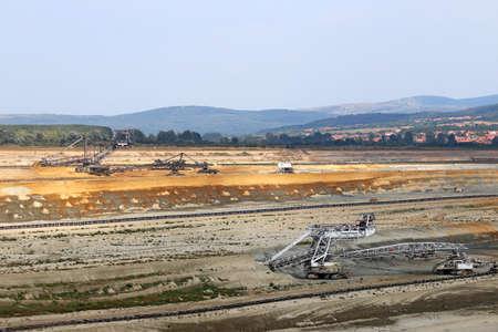 heavy machinery: coal mine with excavators heavy machinery