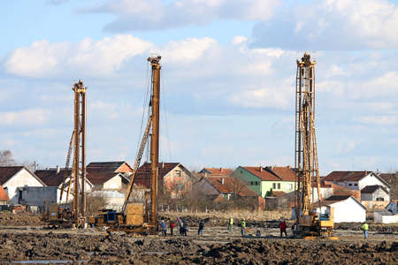 three hydraulic drilling machines on construction site Stock Photo
