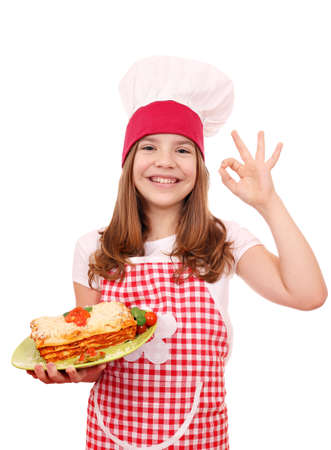 happy little girl cook with Italian lasagne and ok hand sign