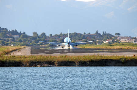 passenger airplane landing on Corfu airport summer season
