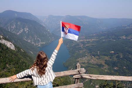 little girl with a Serbian flag on the viewpoint Banjska stena Tara mountain
