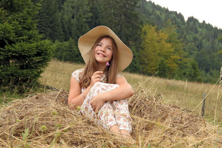 happy little girl enjoys nature summer season photo