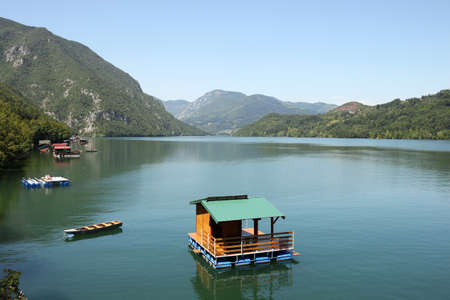 wooden house floating on Drina river landscape Stock Photo