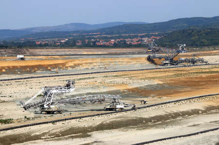 giant excavators digging on open pit coal mine Kostolac Serbia