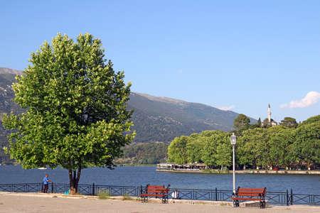 Ioannina lake and Aslan Pasha mosque landscape summer season Stok Fotoğraf