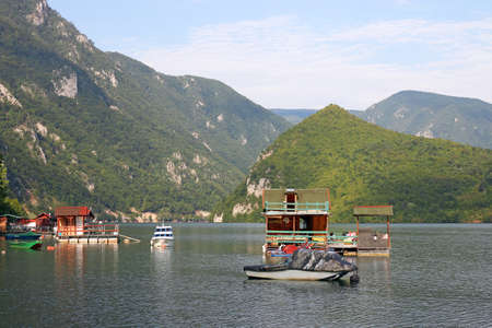 floating houses and boats on river summer season