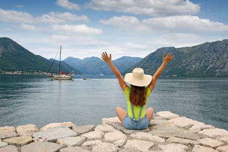 The girl welcomes the sailboat Kotor bay Montenegro summer vacation Banco de Imagens