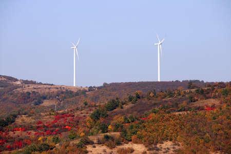 wind turbines on the hill autumn season landscape