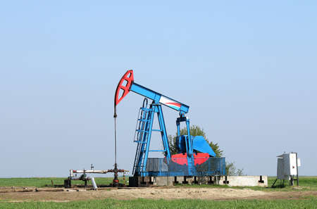 oil pump jack and pipeline on field
