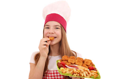 girl cook eats chicken nuggets and french fries Stock Photo