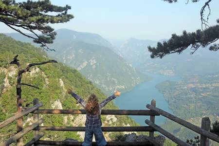 little girl with thumbs up enjoy in nature viewpoint Banjska stena Tara mountain Stock Photo