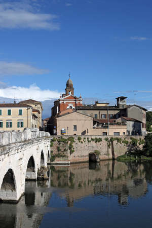 old town and Tiberius bridge in Rimini Italy