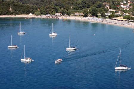 yachts and sailboats on Valtos beach in summer Parga Greece