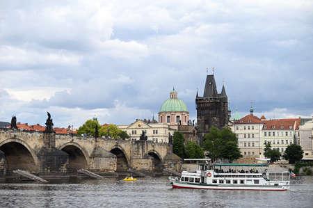 Charles bridge over Vltava river Prague riverside