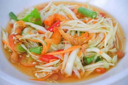 Closeup thai papaya salad (som tum) on white plate