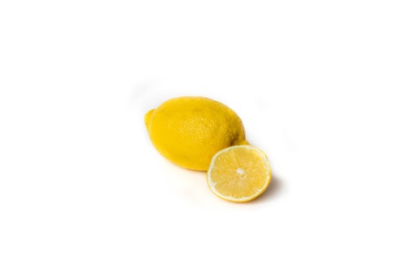 Whole and sliced lemon on white background