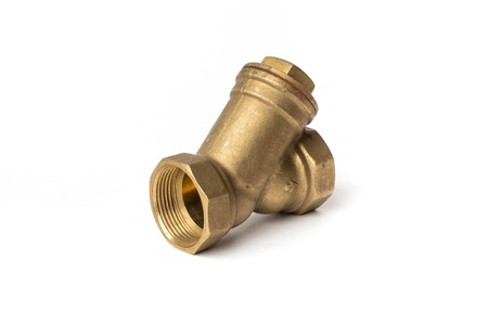 Brass water filter on a white background 스톡 콘텐츠