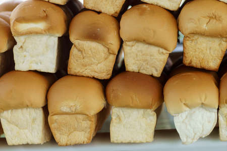 unsliced: Many loaves of fresh bread on the market.