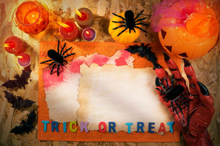 Halloween theme party accessories with monster hand on wooden background , Top view or flat lay with copy space Stock Photo