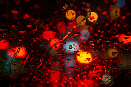 Close up of raindrops on windshield at night in the city Reklamní fotografie