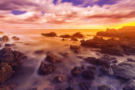 Scenic view of rocky beach, Long exposure of the wave during sunset on the beach. Reklamní fotografie