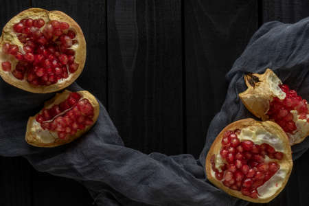Fresh pomegranate on a black background. Free space for text. Top view Reklamní fotografie