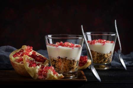 Healthy granola with homemade yogurt parfait and pomegranate