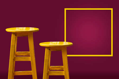 Yellow bar stool with magenta background and copy space frame on the wall Reklamní fotografie