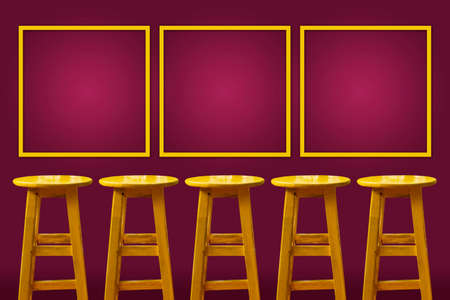 Yellow bar stool with magenta background and copy space frame on the wall, Concept of success and competition Reklamní fotografie