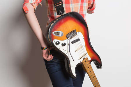 harmonist: girl with a vintage electric guitar is back