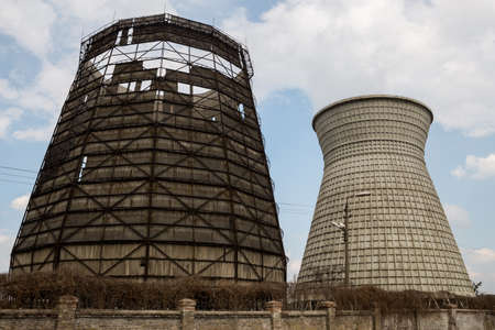 Two thermal towers of a power station against the sky