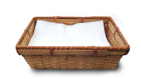 homeware: tissue paper in bamboo basket on white background