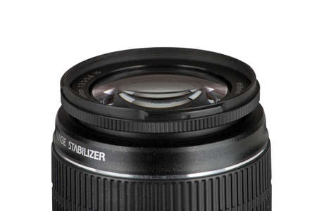 Black lens of a reflex camera isolated on white