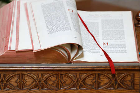 Open old bible in a church. France. Imagens