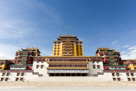 Majestic Buddhist temple under blue sky and white clouds