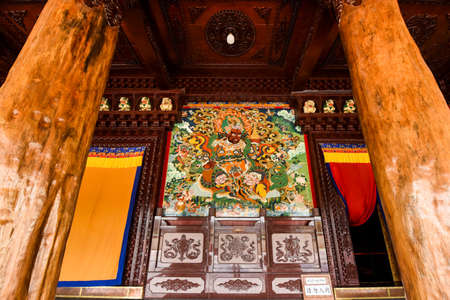 Thangka in front of the porch of a Buddhist temple