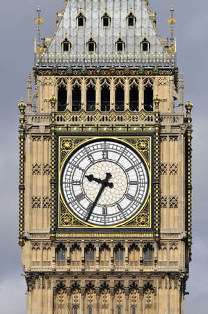 Detail of Big Ben, the Great Clock of Westminster, designed by Augustus Pugin. Set in an iron frame 23 ft in diameter, supporting 312 pieces of opal glass. The surround of the dials is heavily gilded. The inscription means  photo