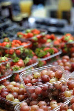 Punnet of red gooseberries on a market stall Stock Photo - 3417624